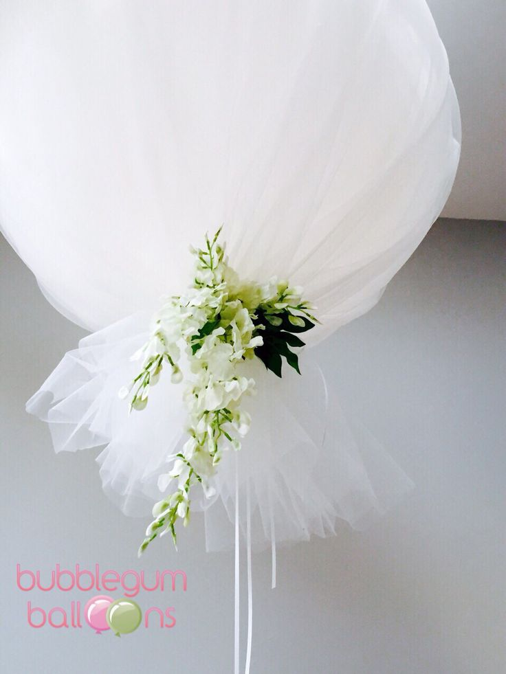 Tulle balloon with wisteria... Beautiful and whimsical.