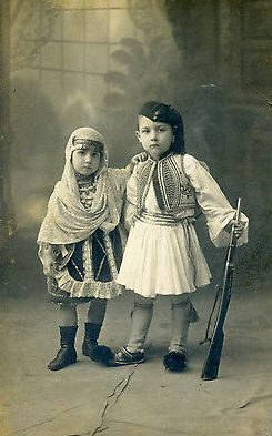HellenicGenealogyGeek.com - Family History Research Tools for Greek Genealogy: Photograph - Greece a Boy Dressed as Tsolias & a Girl Local Dress of Megara, Salamina Aegina - circa 1920