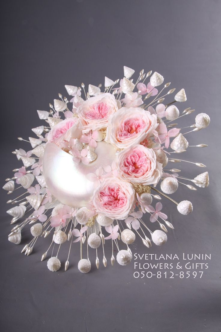 Bridal bouquets from preserved flowers from Japan, polished shells and pearles.