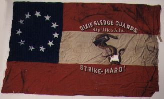 """45th Alabama Infantry (Co. B, Dixie Sledge Guards).  This flag was loaned to the Department of Archives and History by the Robert E. Lee Chapter of the United Daughters of the Confederacy on November 10, 1902. According to two newspaper accounts which accompanied the flag, it was the original """"handsome silk battle flag"""" given to the company (Co. B, Dixie Sledge Guards) by Mr. & Mrs. J. N. Sledge.  In August 1990, the flag was removed from the frame in which it had been since 1902."""