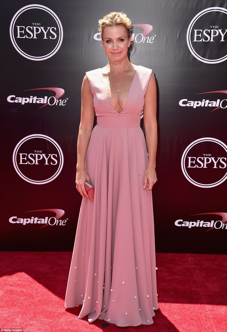 Pretty in pink: ESPN personality Michelle Beadle sported a dusty pink number...