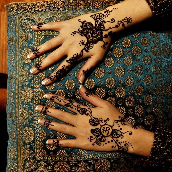 om tattoos for women | Mehndi is a commercial art in South Asia and Afro-Arabia.