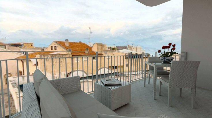 Progetto di arredamento 3D terrazza arredata con gli arredi in midollino corda Varaschin.
