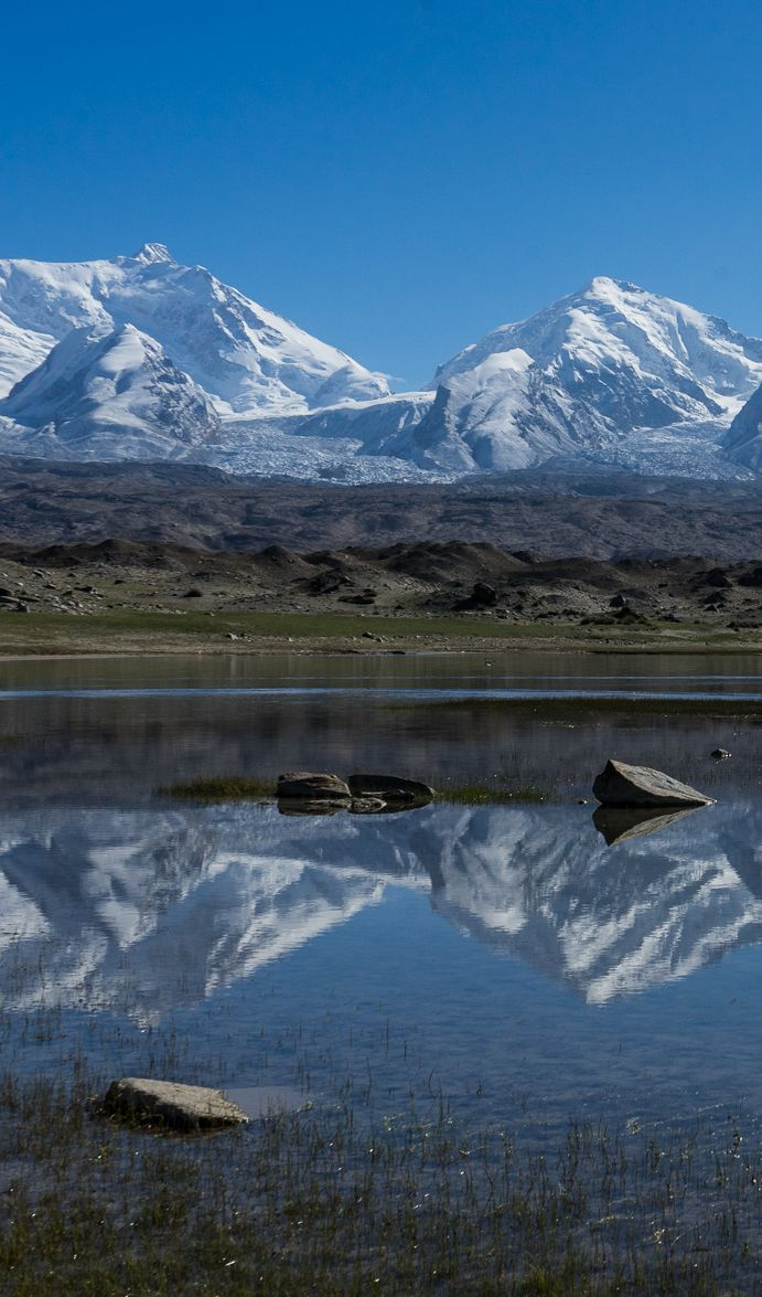Beautiful reflection of the mountains along the Karakorum Highway near Karakol in China. A very beautiful place to go hiking or just relax and take in the views. We went hiking. Here is our guide to trekking along the Karakorum Highway in China.