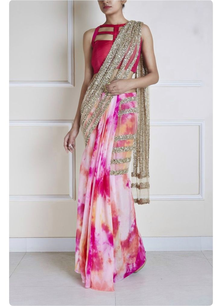 A tie and die Saree with frosted gold pallu and an intricate patterned blouse available at #AyamiiLifeStyleBoutique