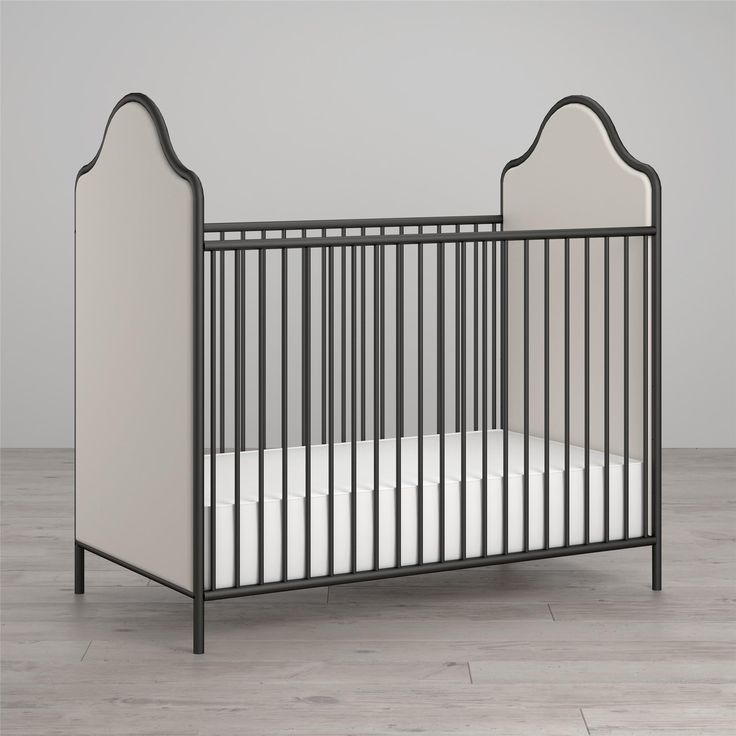 We combined two classic Victorian style elements in this unique crib. Turn-of-the-century fascination with curved metal suggested the shape of the steel frame, finished in black non-toxic paint. The crib end is upholstered and foam-filled, creating a soft look that could have fit in any period home. The mattress base has an adjustable-height feature for safety and easy-reach of growing children. Like all Little Seeds products, this purchase helps support a major Environmental initiative…