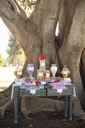 a whimsical willy wonka candy display table for a birthday party photo by siegel thurston