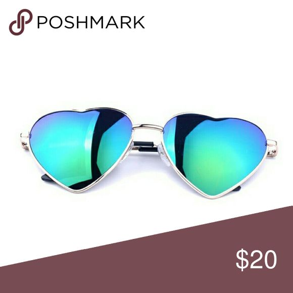 "Heart Shaped Festival Sunglasses NWT! Heart Shaped Festival Sunglasses NWT! Green-blue gradient, UV protection,  approx 2.3"" lense. Get ready for festival season & stand out in the crowd!  No Trades   Use OFFER button to negotiate Please Ask ❓'s BEFORE you Buy Thank you for stopping by! Happy Poshing! Real Haute Trends  Accessories Sunglasses"