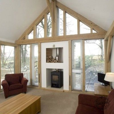 Living Room Interior with Exposed Timber Frame and Glazed Gable End