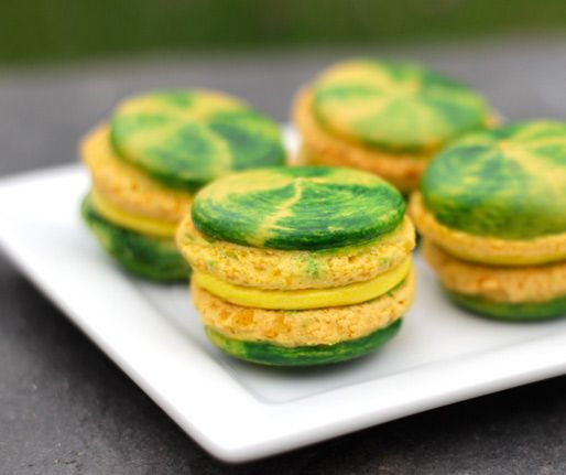 Green and yellow swirled macarons