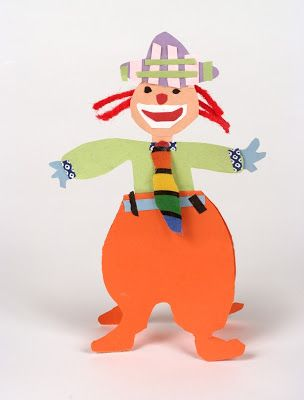 The children use construction paper and glue to create whimsical clowns. For ages 6 to 9