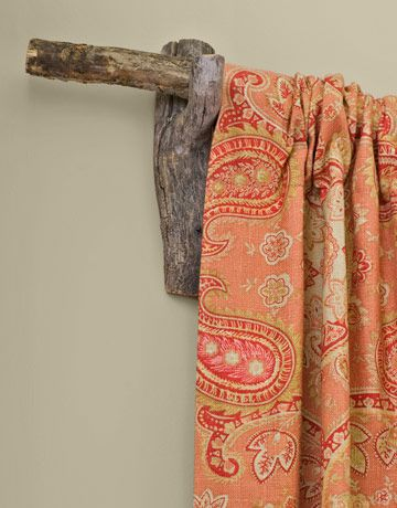 Drapery hung by tree branch turned curtain rod - I already do this and have to say I love the lodgey look.