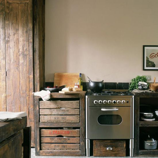 Old crates for drawers, re-used wood panels for pantry.  Simple, nice.  adrift: industrial kitchens
