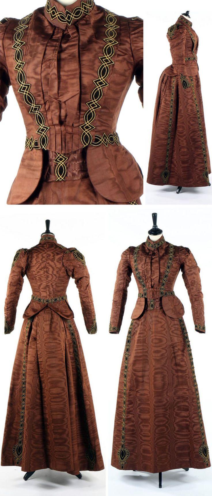 Brown moiré dress ca. 1890. Comprises bodice, skirt, cummerbund with appliquéd velvet strapwork, and silk camisole. Kerry Taylor Auctions
