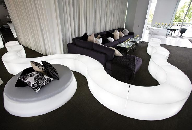 SNAKE and GIO POUF seats, design respectively by SLIDE Studio and Giò Colonna Romano for SLIDE