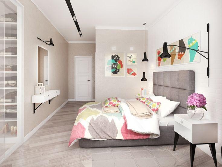 graues Polsterbett mit hohem Kofteil in der Mitte des Schlafzimmers