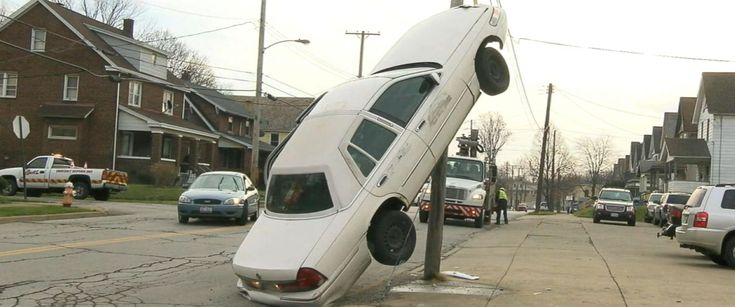 PHOTO:A car in Youngstown, Ohio ended up vertical on a utility pole on Thursday after the driver looked away to feed her child a cookie.