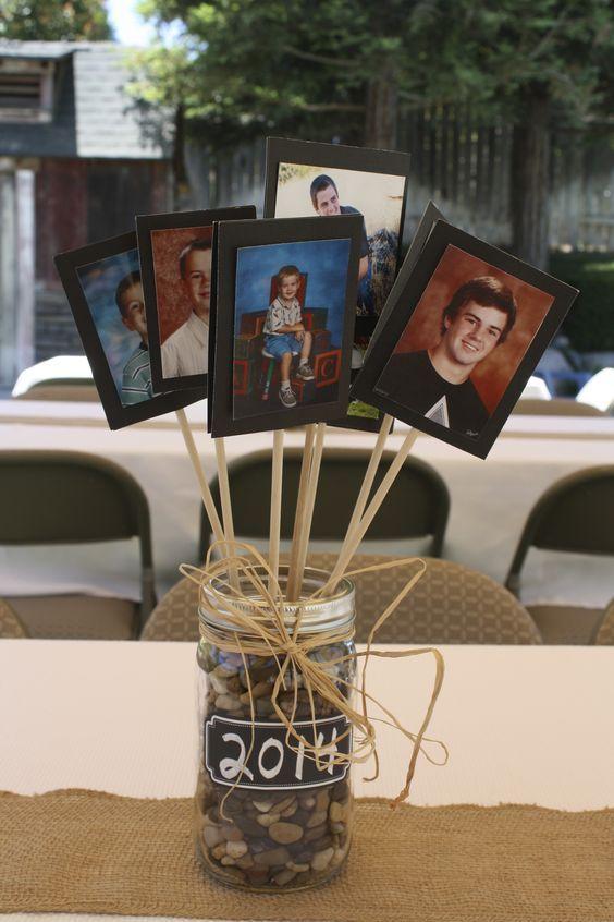 Herzstück für Tische auf einer Abschlussfeier. Gut für Jungs ... keine Blumen. Jedes Bild ist ein Schulbild, auf dem der Absolvent in verschiedenen Qualitäten dargestellt wird: