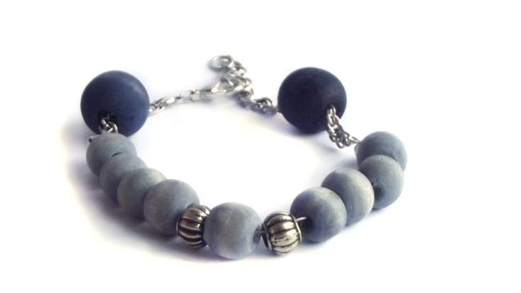Grey and navy with adjustable chain and golden detail bracelet.  for price visit website.
