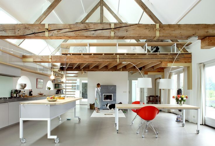 A decaying Dutch barn house in Geldermalsen, Netherlands, has been masterfully restored by Maxwan architecture