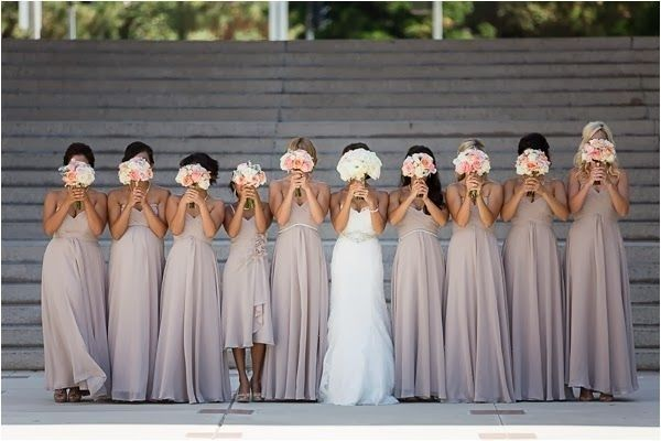 A photo with everyone giving their best bouquet-face.  | 42 Impossibly Fun Wedding Photo Ideas You'll Want To Steal #photo #attire