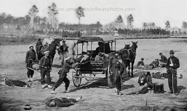 Zouave ambulance crew demonstrating removal of wounded soldiers from the field. Date Created/Published: between 1862 and 1865.
