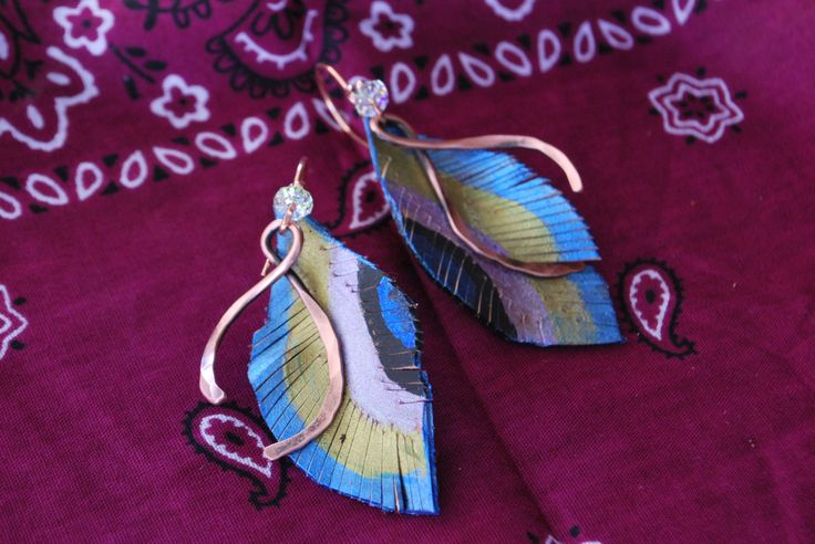 """Peacock Feather Leather Earrings with metallic blue, green, purple and black with Crystal Rhondels and Copper hammered Quills by Bandana Girl All copper French Earwires Approx 1.75"""" long ~ light on the ears Handcrafted Leather work & metal designs Original designs by Bandana Girl - Melinda Orr All jewelry designs come boxed with bandana ribbon :)"""