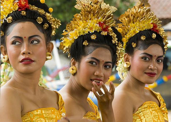 Close-up portraits of young Balinese women wearing traditional costumes at Padang Bai, Bali, Indonesia, Asia. We came across these beautiful women waiting on the pier to entertain cruise ship guests as they left for local tours. We were disembarking the ship that day and David stayed around the pier to capture their smiles, individual and group portraits. Always have your camera ready!
