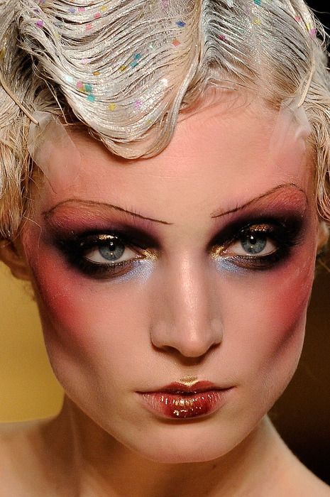 Love the eyebrows and the dark dark rouge. Great look, very hard and worn looking like a showgirl would be.