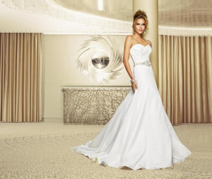Walk in the Park  Silk organza strapless fishtail gown with a soft pleated organza bodice and heavily embellished diamante beaded belt.