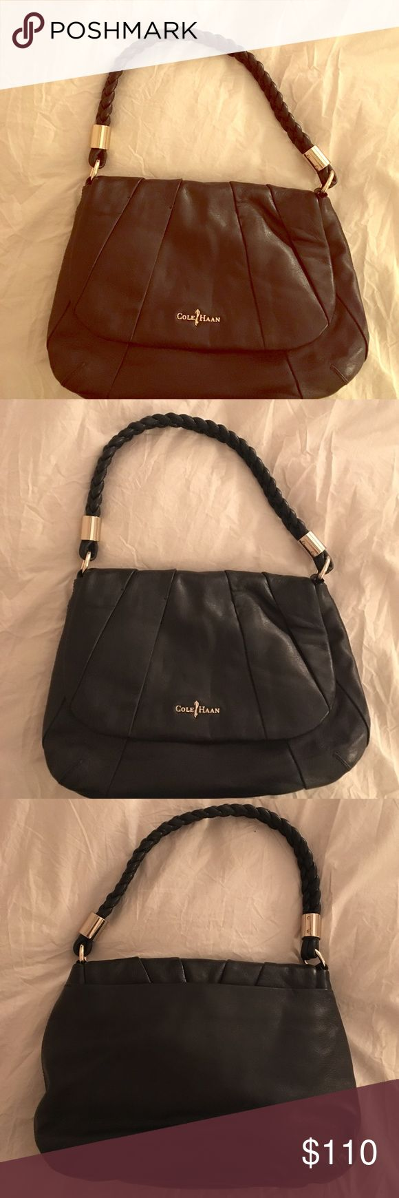 New without tags black leather Cole Haan purse Soft, genuine black leather Cole Haan handbag with braided leather strap and gold accents. Purse measures 13 inches wide and 9 inches top to bottom. The interior is a rich purple with two inside pockets. Thanks for visiting! Cole Haan Bags Shoulder Bags