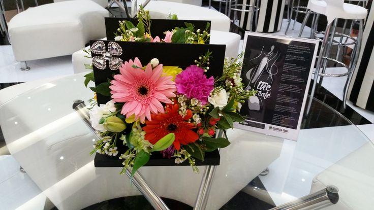 'Art Cafe' Bright coloured flower arrangement in a black wooden frame #Decorex2014