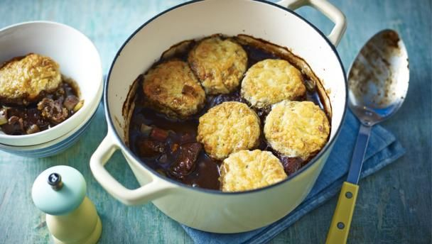 Enjoy the rich taste of tender beef stewed in red wine with a cheese scone topping.