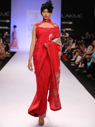 Off-Shoulder Saree-Drape the pallu on your shoulder and pair with a designer ruffled or Chinese-collar blouse.