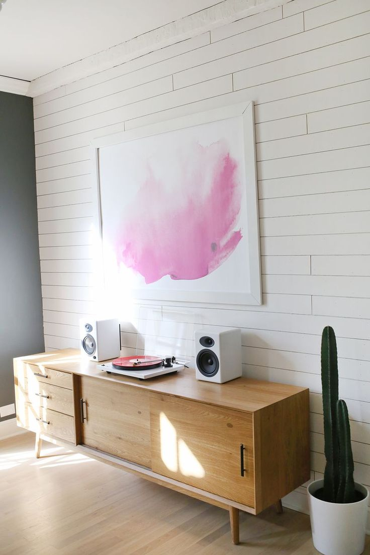 Nice record player setup atop this Mid-century console. The cacti and pop of pink add a nice touch