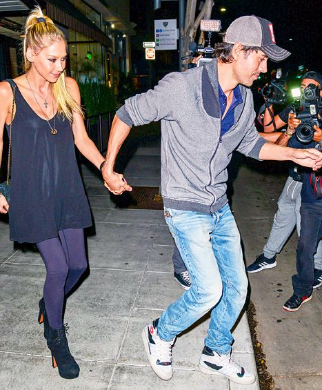 14 Years Strong!   Enrique Iglesias, Anna Kournikova Resurface for Date Night. Smitten since 2001! Enrique Iglesias and Anna Kournikova are still going strong 14 years later. The singer, 40, and former tennis pro, 34, resurfaced for a date night at the Palm restaurant in Beverly Hills on Thursday, Aug. 6    @usweekly
