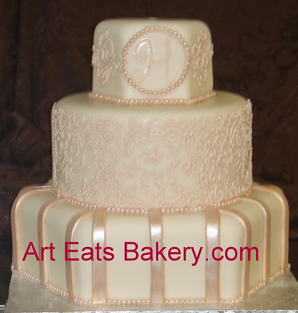 Custom round and hexagon ivory and champagne monogram and lace fondant wedding cake design by arteatsbakery, via Flickr