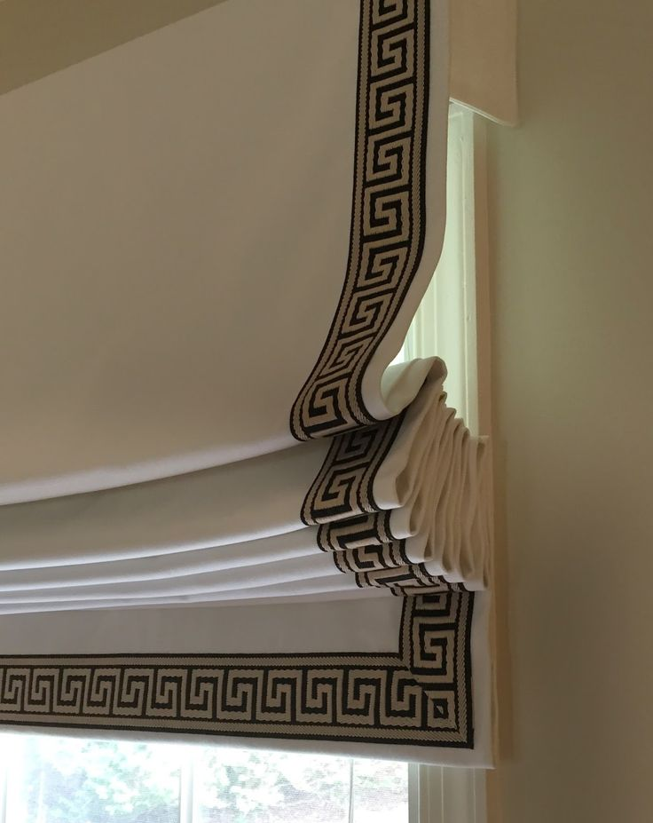 Ivory twill roman shades with greek key trim