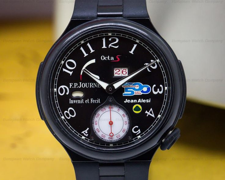 """FP Journe Octa Sport """"JEAN ALESI"""" limited edition to 99 pieces commemorating Jean Alesi's participation in the Indianapolis 500, blackened aluminum case on a rubber strap with an aluminum deployment buckle, the case has wear on the surface of the ceramic around the bezel, FP Journe caliber, power reserve, date indicator, day / night indicator, crown at 4 o clock, black dial with luminous hands and arabic numerals, Jean Alesi on the dial along with the Lotus racing symbol and Indy 500 logo.."""