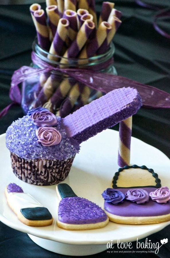 * Alayna Posh Purple: High heel cupcake with matching purse and make-up cookies. http://ailovebaking.com/2013/08/12/edible-fashion-high-heel-cupcakes-and-make-up-and-purse-cookies/
