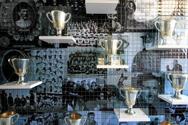 Tiled background graphics. Trophies on shelves on wall. Simply place pane of glass in front instead of getting a cabinet?