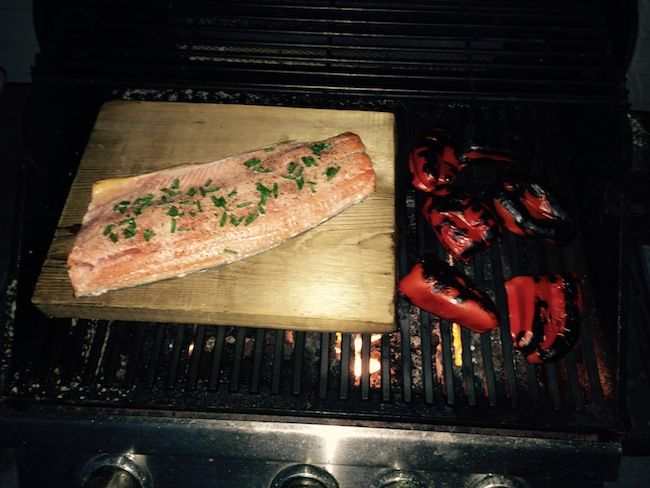 Cedar Plank Salmon is such a lovely treat: Use a thick non treated plank of cedar. Heat the board in the BBQ and place lightly seasoned salmon (salt, pepper & thinly sliced green onions, lemon juice) on the board for approx 20 minutes. The board will smoke as it burns but the salmon takes on the aromatic cedar taste. Yum!