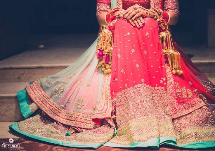 kalire with round embellishments is enhancing the overall look of red and blue bridal lehenga  #trending #trendingbridalaccessories ##accessoriesideas #latestbridaltrend #goldenkalire #beautifuljewellery
