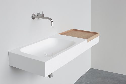 NotOnlyWhite Box basin | White Hi-Macs | Natural oak box | The Box collection is the answer to a tidy bathroom. Finally, everyday items like hairbrush and toothpaste have a home of their own.