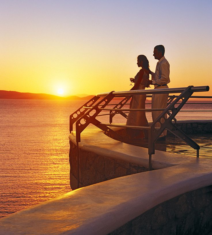 """Here you yearn to live, taste, feel, let yourself go, touch, breathe. Here, """"now or never"""" is a way of life. Here you feel fortunate, attractive, warm, passionate… Mykonos Grand Hotel & Resort"""