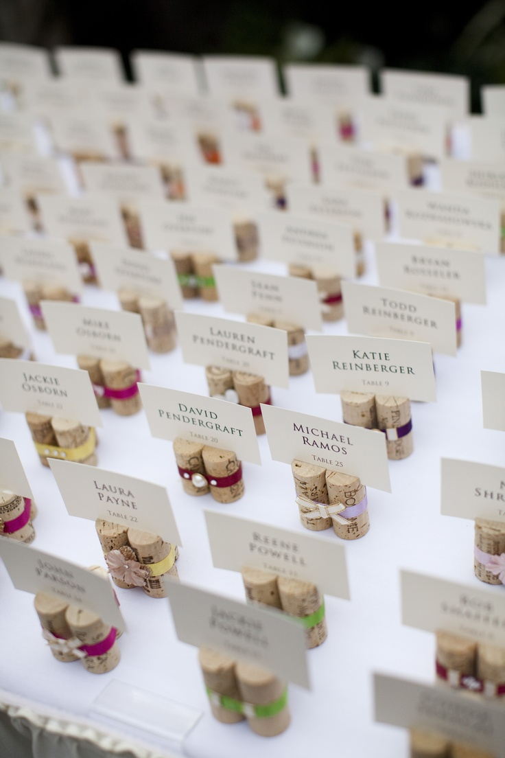 Name cards one with a bow tie and the other with bouquet