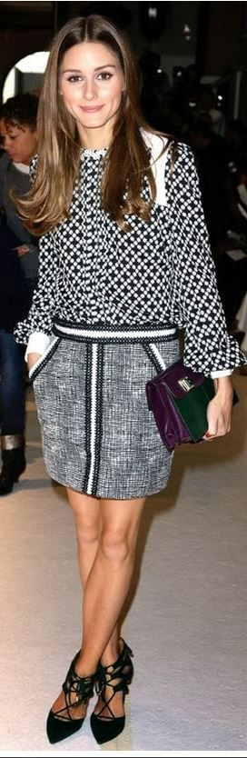 Who made Olivia Palermo's white print shirt, black print skirt, and green lace up pumps? Shirt and skirt – Andrew Gn  Shoes – Aquazzura