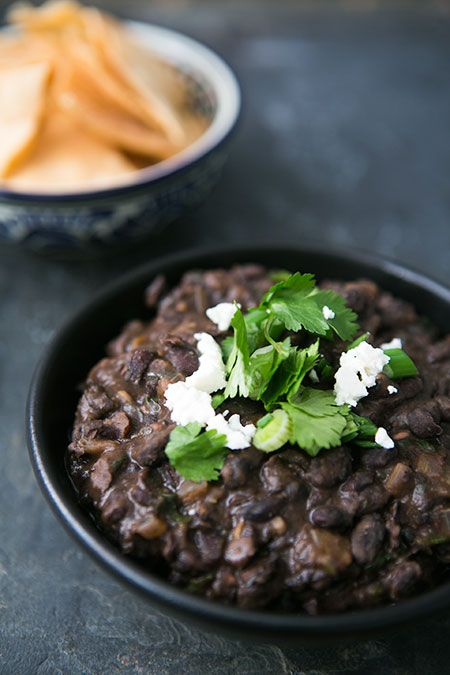 Perfect side to Mexican dishes, these black beans are first cooked from scratch with cilantro, garlic, and onions, and then fried with chili powder and cumin. Also great for dipping with tortilla chips! On SimplyRecipes.com
