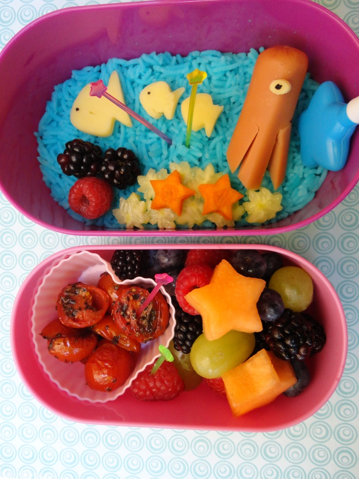 Summer Star Bento : Hotdog Octopus, White Gouda fishes, cucumber kelp & carrot star fish, raspberry & blackberry sea anemone on a bed of blue rice. Sautéed basil tomatoes in a heart shaped silicone cup with berry fruit salad and star shaped sweet melons.