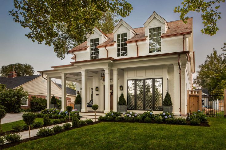 Timeless house exterior by The Fox Group. #houseexterior #curbappeal #timelessdesign #newconstruction #housedesign #traditionalarchitecture